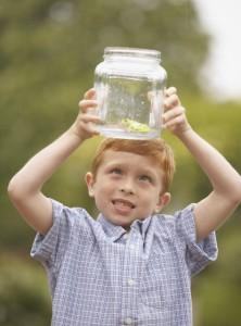 boy observing frog