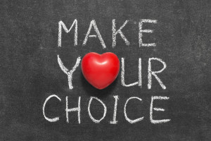 make your choice phrase handwritten on blackboard with heart symbol instead of O